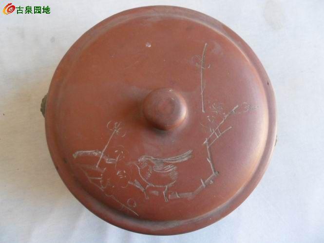 七八十年代的东西,不过好歹是个老紫砂的物件,实用还是不错的,难